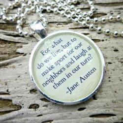 Jane Austin. Pride &amp; Prejudice. Round silver bezel and glass ball chain necklace. For what do we live, but to make sport for our neighbors and laugh at them in our turn. Glass Dome. Metal bezel. Ball chain.